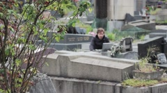 Sad Man Cryies At Grave In Cemetery - stock footage