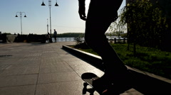Man doing a trick on a skateboard. Silhouette on a background of the sun Stock Footage