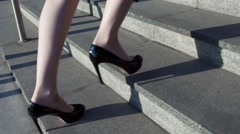 Close-up business woman legs hurry walking in heels on the stairs Stock Footage