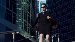 Young business woman in hurry running to a meeting - stock footage