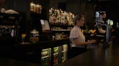 4K Portrait smiling bar worker standing behind counter in fashionable city bar Stock Footage