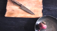 Organic red beets with green leaves on an old wooden table. Rustic style Stock Footage