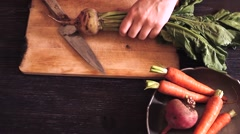 FoodOrganic red beets with green leaves on an old wooden table. Rustic style Stock Footage