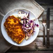 Chicken schnitzel with red cabbage,pears and gorgonzola - stock photo