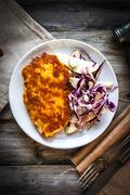 Chicken schnitzel with red cabbage,pears and gorgonzola Stock Photos