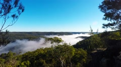 Winter Morning Fog Clearing Over the Valley and River  Stock Footage