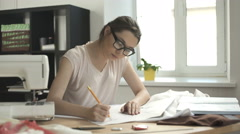Designer creates a sketch on the paper Stock Footage
