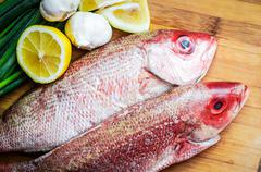 Fresh Red Snapper Preparation With Lemon And Vegetables - stock photo