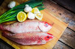 Fresh Red Snapper Preparation With Lemon And Vegetables Stock Photos