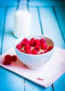 Granola With Raspberries In A Bowl On Wooden Background Stock Photos