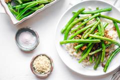 Meat with rice and green beans Stock Photos