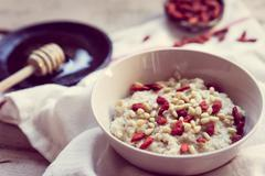 Oatmeal with berries and nuts Stock Photos