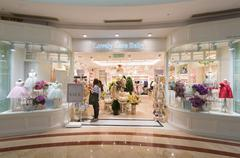 childrens clothes store in Suria KLCC, Kuala Lumpur - stock photo