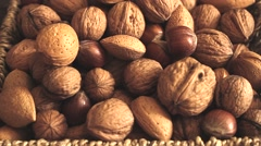 Different types of nuts: walnut hazelnut cashew peanuts brazil nuts pine Stock Footage