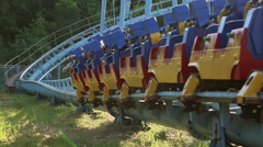 Rollercoaster train is moving along the track - stock footage