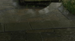 Rain and lightning pouring onto stone steps-slider shot Stock Footage