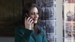 elated woman on the phone after receiving good news - stock footage