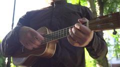 Man Playing the Ukulele Stock Footage