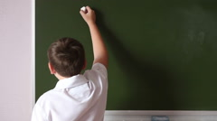 Teen student solves an example on the blackboard Stock Footage