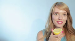 girl biting a lemon - stock footage