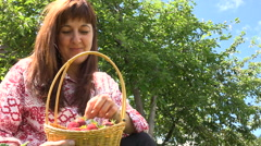 Woman Collects Garden Strawberries in a Wicker Basket. Perspective From Below Stock Footage