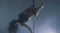 Attractive sexy woman pole dancer performing against grey background. - stock footage