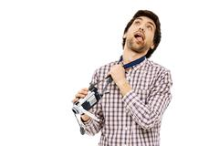 Portrait of handsome young man strangling himself - stock photo