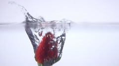 Strawberry falls into the water, slow motion Stock Footage