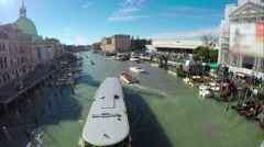 Many tourists visiting colourful buildings and narrow canal of Venice Stock Footage