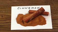 Cinnamon on an old wooden table Stock Footage
