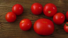 Red tomatoes on old wooden table - stock footage