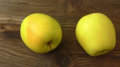 Two apples on old wood table - stock footage