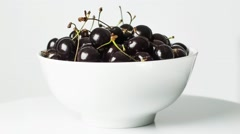 Cherries in white bowl. rotating. Still life. Stock Footage
