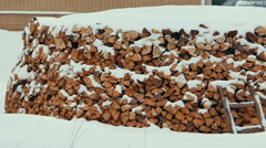 Firewood in a Stack Under Snow Stock Footage