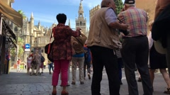 Group of tourists making a photo from the Seville Cathedral in Spain Stock Footage