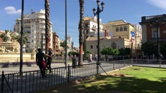 Horse and carriage passing by the Fountain Puerta de Jerez Stock Footage