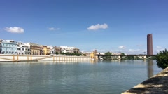 The canal de Alfonso XIII with the Puerto Triana tower Stock Footage