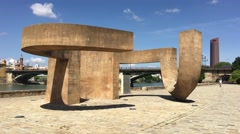 Art object in front of the Puente de Isabel II Bridge in Seville Stock Footage
