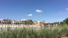 The canal de Alfonso XIII with the Puente de Isabel II Bridge Stock Footage