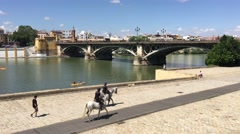 Police riding a horse along the canal de Alfonso XIII Stock Footage
