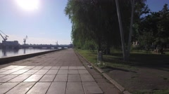 Movement along the embankment of the river, paving slabs, bridge Stock Footage