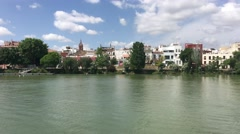 Houses along the Canal de Alfonso XIII in Seville Stock Footage