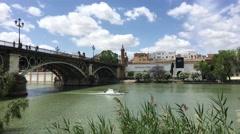 Puente de Isabel II Bridge over the Canal de Alfonso XIII in Seville Stock Footage