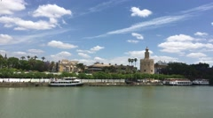 The Canal de Alfonso XIII with the Torre del Oro in Seville Stock Footage