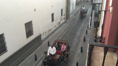 Horse and carriages in the old town of Seville Stock Footage