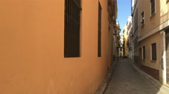 Narrow street in the old town of Seville Stock Footage