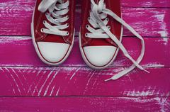 Pair of red sneakers with white laces Stock Photos