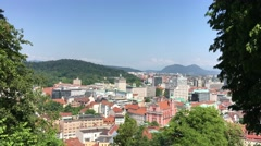 View over Ljubljana old town on the way to the Ljubljana Castle Stock Footage