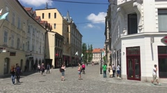 Tourists walking at the town square in the old town of Ljubljana Stock Footage
