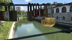 Love locks at the Butchers Bridge over the Ljubljanica river - stock footage